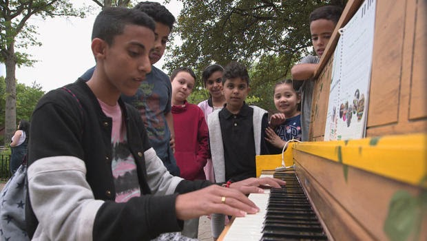 Sing for Hope kids playing piano